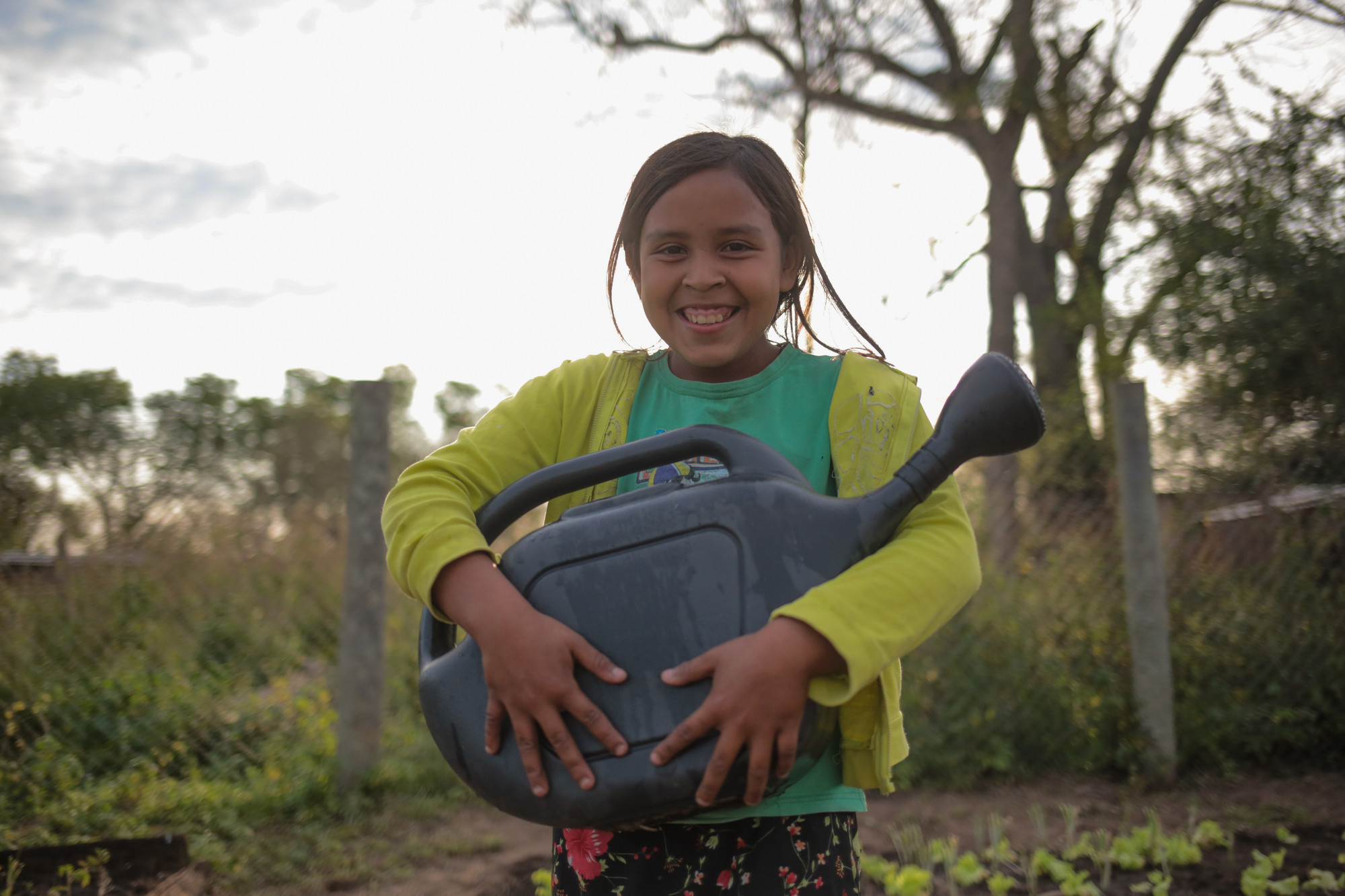 10-year-old Mercedes Benitez in her Community Garden